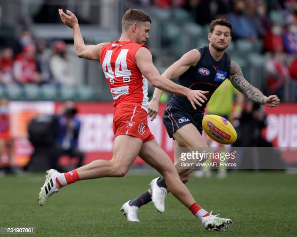 Jake Lloyd of the Swans kicks the ball during the 2021 AFL Second Elimination Final match between the Sydney Swans and the GWS Giants at University...