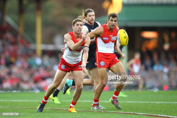 Jake Lloyd of the Swans passes during the round 23 AFL match between the Sydney Swans and the Carlton Blues at Sydney Cricket Ground on August 26...