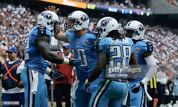 Jake Locker of the Tennessee Titans celebrates with Delanie Walker after a touchdown in the second half against the Houston Texans at Reliant Stadium...