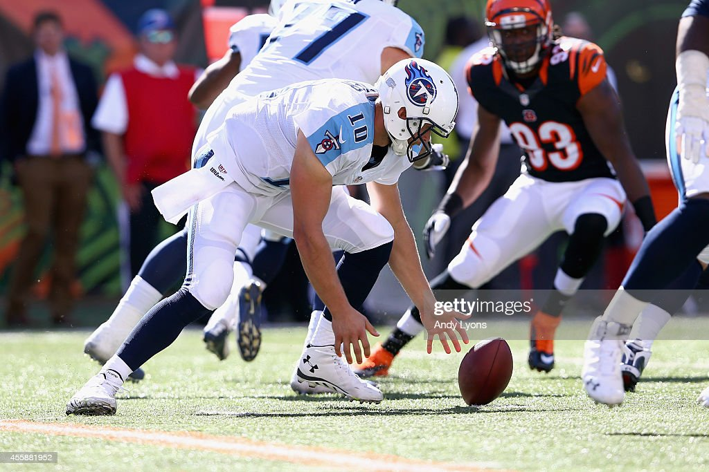 Jake Locker #10 of the Tennessee Titans reaches for a fumble during the game against the Cincinnati Bengals at Paul Brown Stadium on September 21, 2014 in Cincinnati, Ohio.