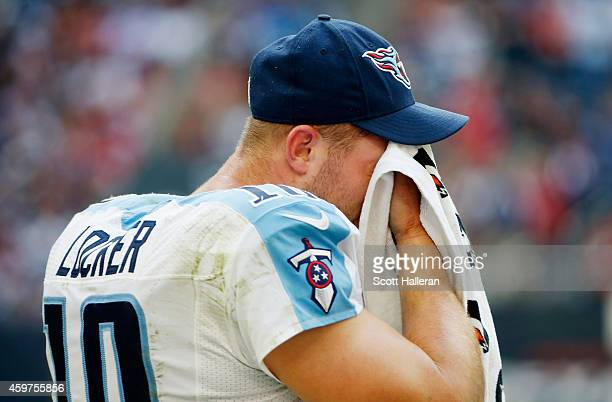 Jake Locker of the Tennessee Titans waits on the sidelines in the second half of their game against the Houston Texans at NRG Stadium on November 30...