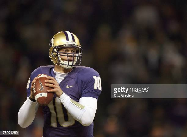 Jake Locker of the Washington Huskies looks to pass during the 100th Apple Cup game against the Washington State Cougars at Husky Stadium on November...