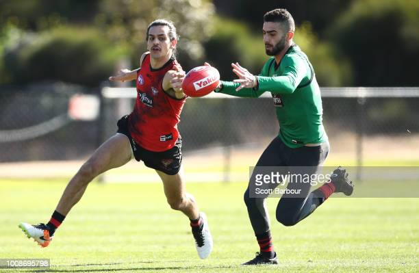 Jake Long of the Bombers and Adam Saad of the Bombers compete for the ball during an Essendon Bombers AFL training session at The Hangar on August 1...
