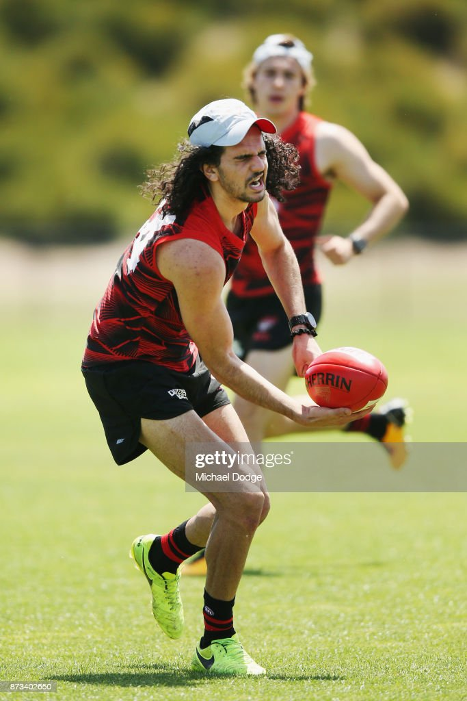 Jake Long of the Bombers reacts after getting something in his eye during an Essendon Bombers AFL training session at the Essendon Football Club on November 13, 2017 in Melbourne, Australia.