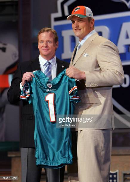 Jake Long poses for a photo after being taken as the first overall draft pick by the Miami Dolphins with National Football League Commissioner Roger...