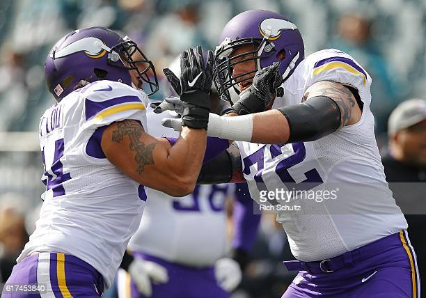 Jake Long son of former Oakland Raiders Howie Long warms up with Justin Trattou both of the Minnesota Vikings before taking on the Philadelphia...