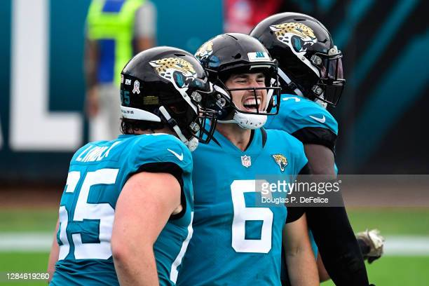Jake Luton of the Jacksonville Jaguars celebrates a touchdown during the second half against the Houston Texans at TIAA Bank Field on November 08,...