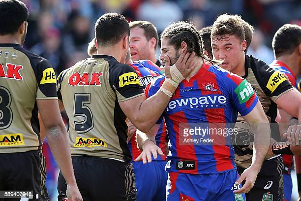 Jake Mamo of the Knights and Dalin WateneZelezniak of the Panthers during an altercation during the round 23 NRL match between the Newcastle Knights...