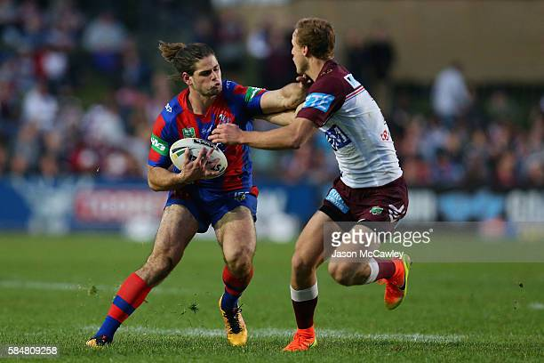 Jake Mamo of the Knights is tackled by Daly CherryEvans of the Sea Eagles during the round 21 NRL match between the Manly Sea Eagles and the...
