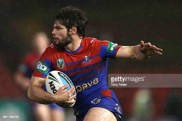 Jake Mamo of the Knights runs the ball during the round 19 NRL match between the Newcastle Knights and the Gold Coast Titans at Hunter Stadium on...