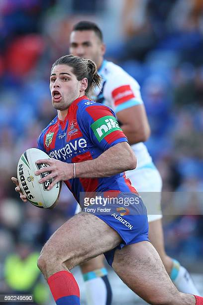 Jake Mamo of the Knights runs the ball during the round 24 NRL match between the Newcastle Knights and the Gold Coast Titans at Hunter Stadium on...