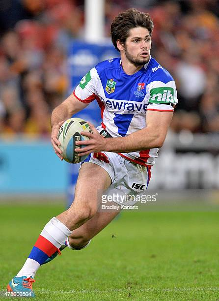 Jake Mamo of the Knights runs with the ball during the round 16 NRL match between the Brisbane Broncos and the Newcastle Knights at Suncorp Stadium...