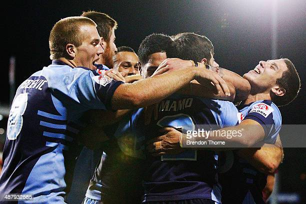 Jake Mamo of the NSW celebrates with team mates after scoring a try during the U20's State of Origin match between the New South Wales Blues and the...