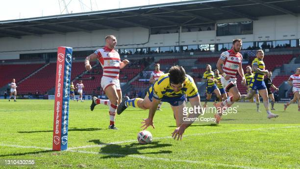 Jake Mamo of Warrington scores a first half try during the Betfred Super League match between Warrington Wolves and Leigh Centurions at Totally...