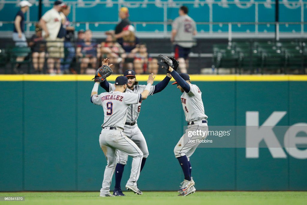 Jake Marisnick #6, George Springer #4 and Marwin Gonzalez #9 of the Houston Astros celebrate after the game against the Cleveland Indians at Progressive Field on May 25, 2018 in Cleveland, Ohio. The Astros won 11-2.