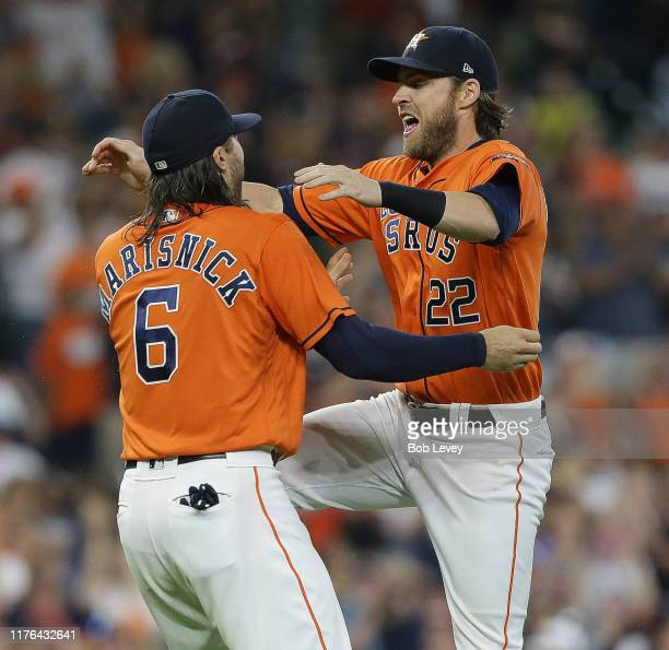 Jake Marisnick of the Houston Astros and Josh Reddick celebrate after winning the American League West Division after defeating the Los Angeles...