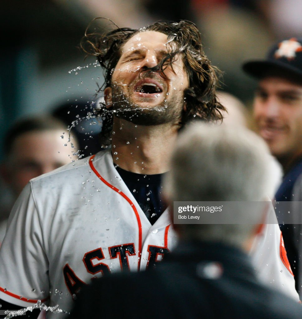 Jake Marisnick #6 of the Houston Astros celebrates in the dugout after hitting a home run in the fifth inning against the Los Angeles Angels of Anaheim at Minute Maid Park on April 20, 2017 in Houston, Texas.