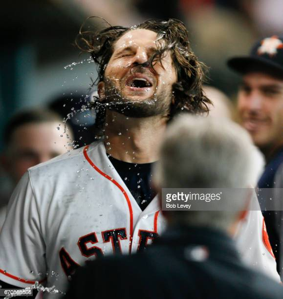 Jake Marisnick of the Houston Astros celebrates in the dugout after hitting a home run in the fifth inning against the Los Angeles Angels of Anaheim...