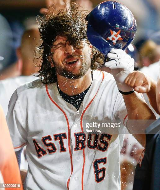Jake Marisnick of the Houston Astros celebrates in the dugout after htting a three run home run in the third inning against the Tampa Bay Rays at...