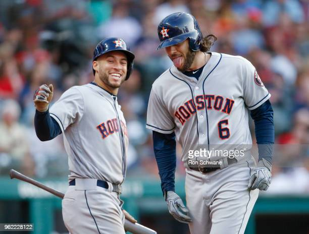 Jake Marisnick of the Houston Astros celebrates with George Springer after hitting a threerun home run off Neil Ramirez of the Cleveland Indians...