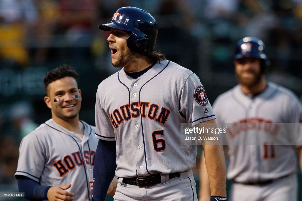 Jake Marisnick #6 of the Houston Astros celebrates with Jose Altuve #27 and Evan Gattis #11 after hitting a two run home run against the Oakland Athletics during the fifth inning at the Oakland Coliseum on June 19, 2017 in Oakland, California. The Houston Astros defeated the Oakland Athletics 4-1.