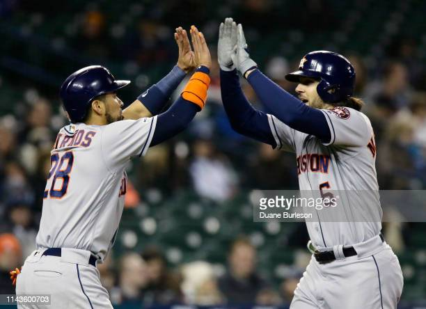 Jake Marisnick of the Houston Astros celebrates with Robinson Chirinos of the Houston Astros after hitting a tworun home run against the Detroit...