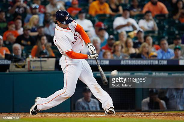 Jake Marisnick of the Houston Astros connects on a threerun home run during the seventh inning of their game against the Seattle Mariners at Minute...