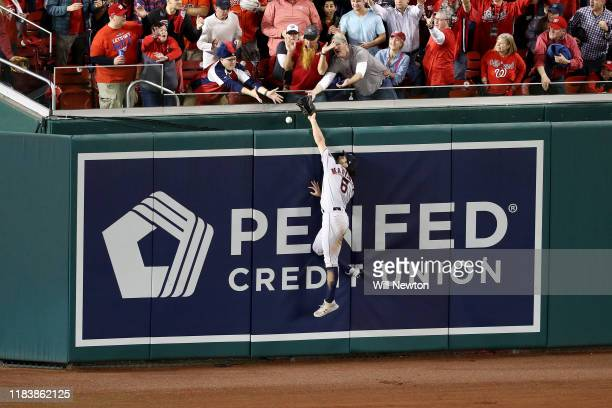 Jake Marisnick of the Houston Astros fails to catch a solo home run hit by Juan Soto of the Washington Nationals during the seventh inning in Game...