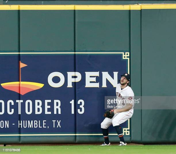 Jake Marisnick of the Houston Astros fails to make a catch on a home run by Eloy Jimenez of the Chicago White Sox in the second inning at Minute Maid...