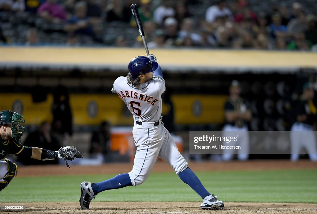 Jake Marisnick #6 of the Houston Astros hits a sacrifice fly scoring Alex Bregman #2 against the Oakland Athletics in the top of the eighth inning at Oakland Alameda Coliseum on June 21, 2017 in Oakland, California. The Astros won the game 5-1.