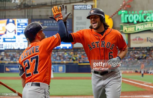 Jake Marisnick of the Houston Astros is congratulated by Jose Altuve after his solo home run in the third inning of a baseball game at Tropicana...
