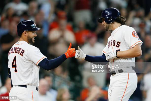 Jake Marisnick of the Houston Astros is congraturlated by George Springer of the Houston Astros after hitting a home run in the fifth inning against...