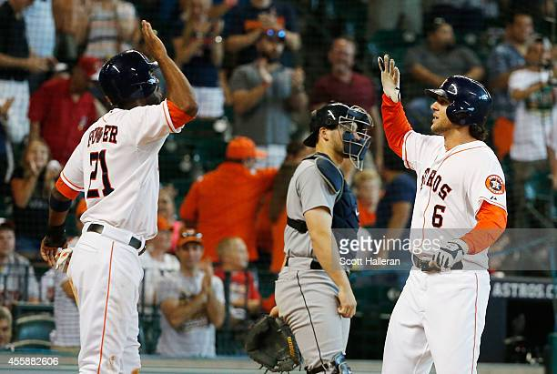Jake Marisnick of the Houston Astros is greeted by Dexter Fowler after Marisnick hit a threerun home run during the seventh inning of their game...