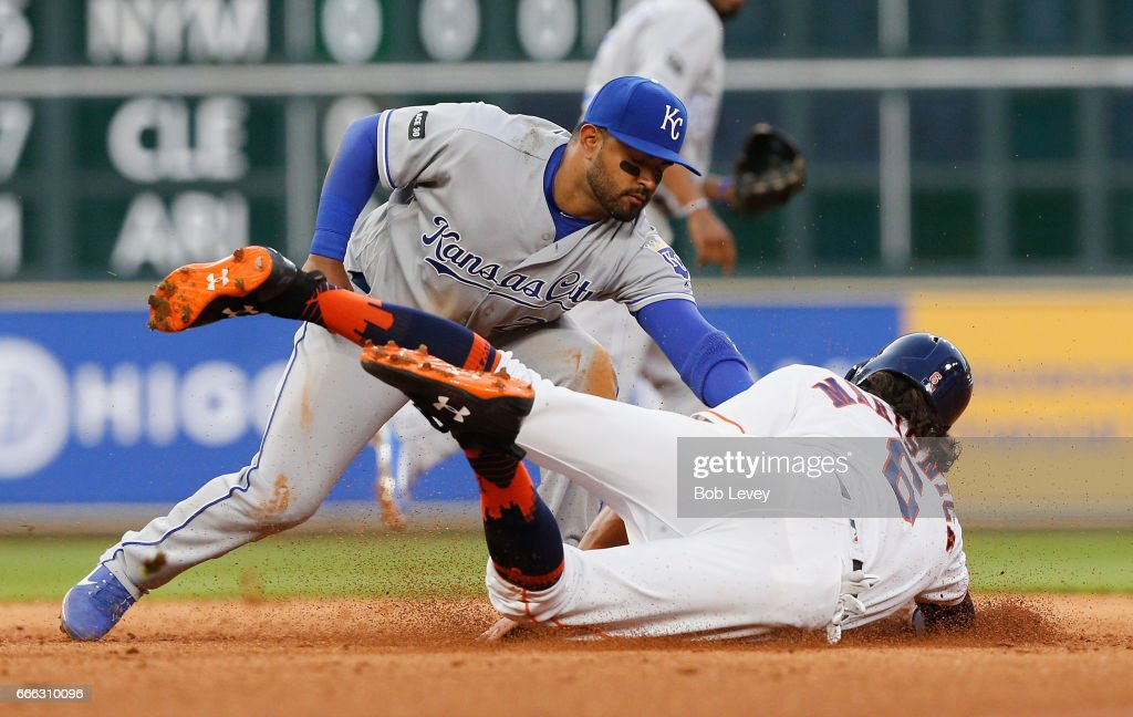 Jake Marisnick #6 of the Houston Astros is tagged out by Christian Colon #24 of the Kansas City Royals in the fifth inning at Minute Maid Park on April 8, 2017 in Houston, Texas.