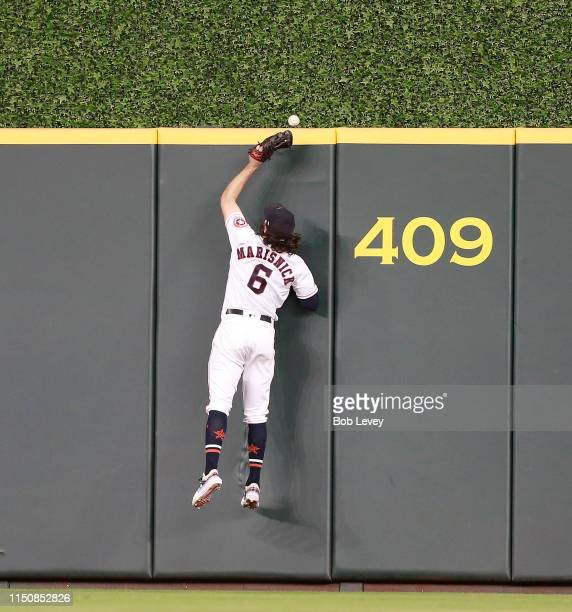 Jake Marisnick of the Houston Astros leaps at the wall but is unable to catch a ball off the bat of Jose Abreu of the Chicago White Sox that cleared...