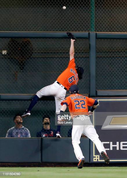 Jake Marisnick of the Houston Astros leaps at the wall but is unable to make the catch on a deep fly ball by Mookie Betts of the Boston Red Sox in...