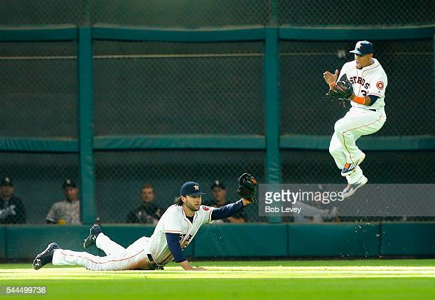 Jake Marisnick of the Houston Astros makes a diving catch on a line drive by Jose Abreu of the Chicago White Sox seventh inning as Carlos Gomez...