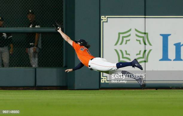 Jake Marisnick of the Houston Astros makes a diving catch on a line drive by Adam Engel of the Chicago White Sox in the eighth inning at Minute Maid...