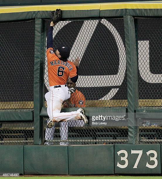 Jake Marisnick of the Houston Astros makes a leaping attempt at the wall but can't make the catch on Kyle Seager of the Seattle Mariners home run in...