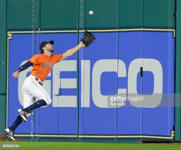 Jake Marisnick of the Houston Astros makes a running attempt on a line drive by Kendrys Morales of the Toronto Blue Jays in the sixth inning at...