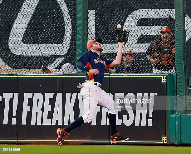 Jake Marisnick of the Houston Astros runs down a deep fly ball off the bat of Luke Maile of the Tampa Bay Rays in the third inning at Minute Maid...