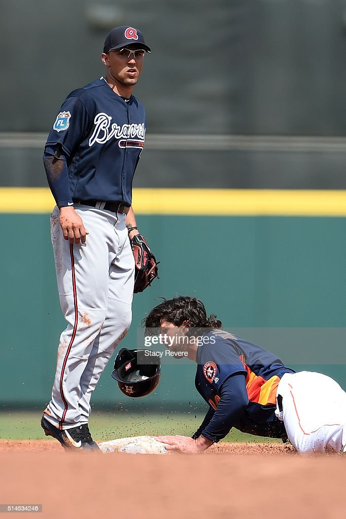 Jake Marisnick #6 of the Houston Astros safely steals second base during the second inning of a spring training game against the Atlanta Braves at Osceola County Stadium on March 9, 2016 in Kissimmee, Florida.