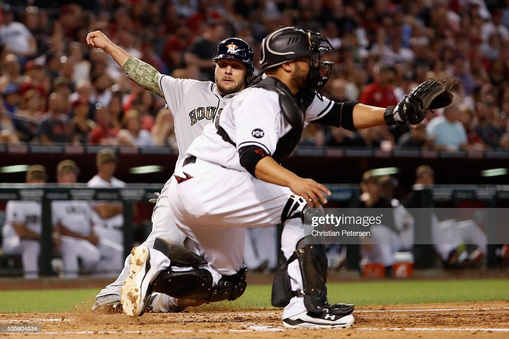 Jake Marisnick #6 of the Houston Astros slides past catcher Welington Castillo #7 of the Arizona Diamondbacks to score a run during the third inning of the MLB game at Chase Field on May 30, 2016 in Phoenix, Arizona.