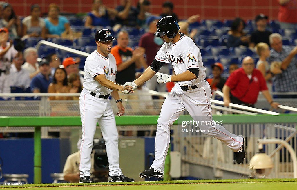 Jake Marisnick #23 of the Miami Marlins hits his first major league home run during a game against the New York Mets at Marlins Park on July 31, 2013 in Miami, Florida.