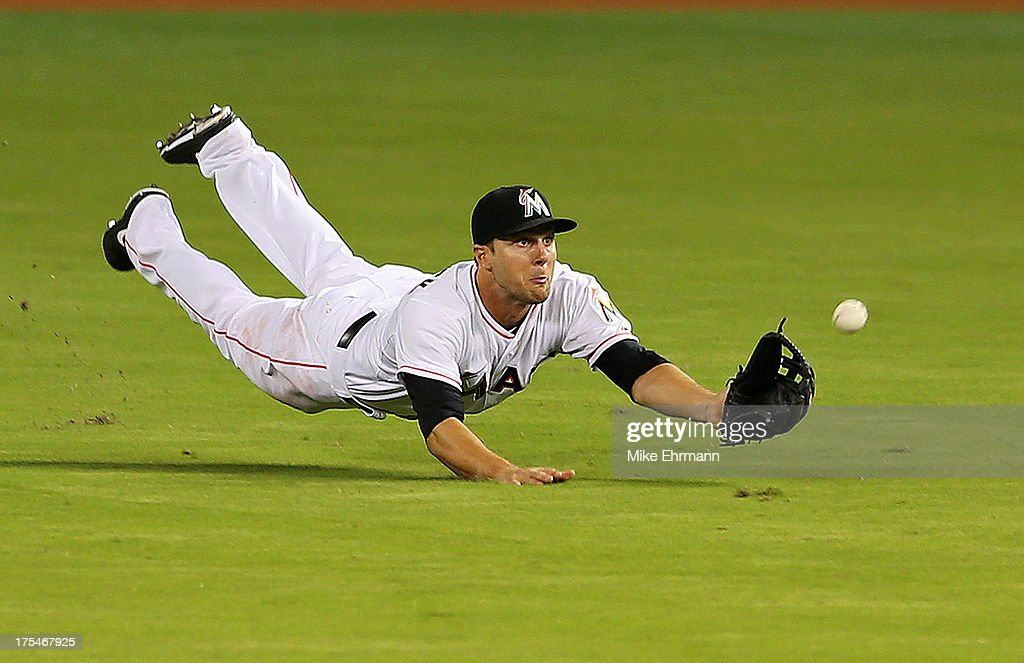 Jake Marisnick #23 of the Miami Marlins misses a fly ball during a game against the Cleveland Indians at Marlins Park on August 3, 2013 in Miami, Florida.