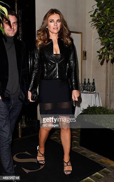 Jake Maskall and Elizabeth Hurley leave Scott's restaurant in Mayfair on September 19 2015 in London England