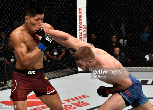 Jake Matthews of Australia punches Li Jingliang of China in their welterweight bout during the UFC 221 event at Perth Arena on February 11 2018 in...