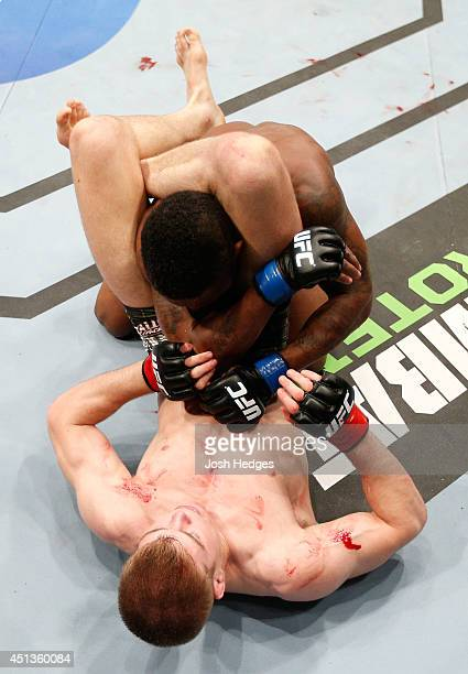 Jake Matthews secures a triangle choke submission against Dashon Johnson in their lightweight fight during the UFC Fight Night event at Vector Arena...