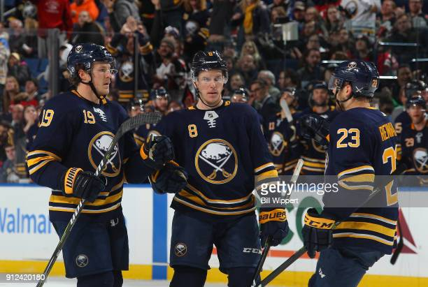 Jake McCabe of the Buffalo Sabres celebrates his third period goal against the New Jersey Devils with Casey Nelson and Sam Reinhart during an NHL...