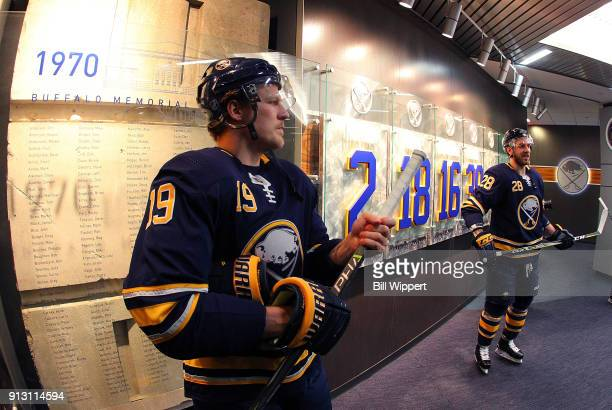 Jake McCabe of the Buffalo Sabres prepares before an NHL game against the New Jersey Devils on January 30 2018 at KeyBank Center in Buffalo New York...